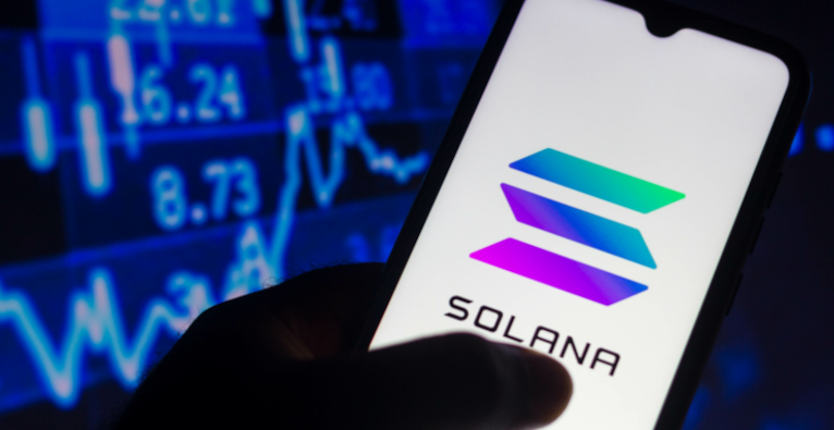 In this photo illustration the Solana logo seen displayed on a smartphone.